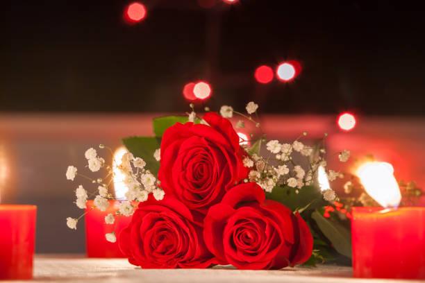 Fresh roses in a romantic dinner setting picture id817147778?b=1&k=6&m=817147778&s=612x612&w=0&h=swqm4staaq bwc w9ql  xpkrpzaw npb 5xkvvihti=