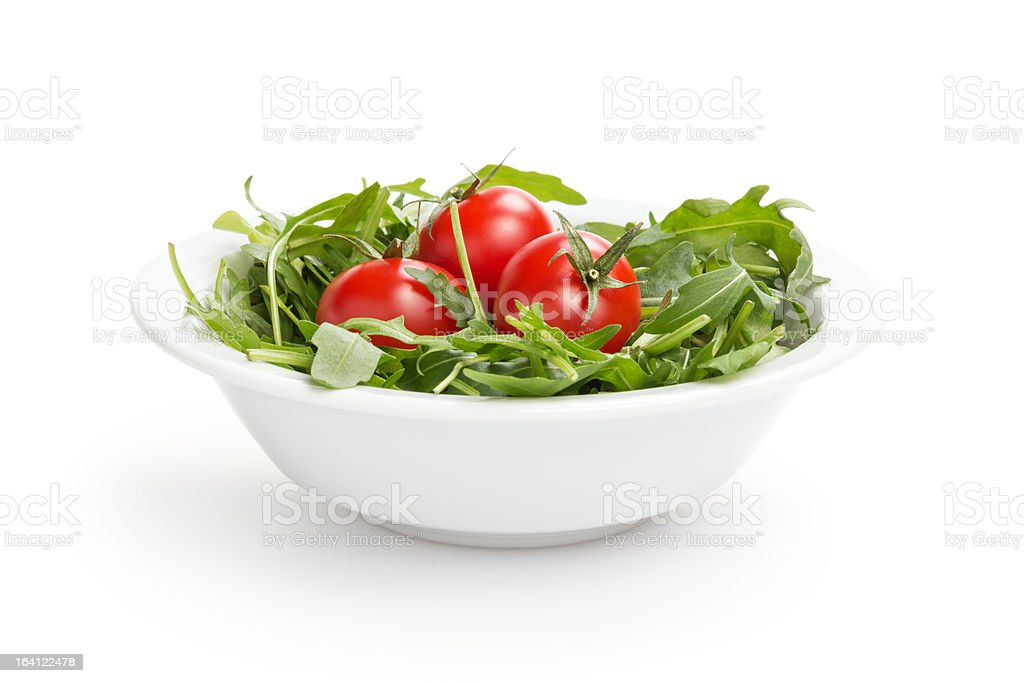 fresh rucola leaves in a bowl with tomatoes royalty-free stock photo