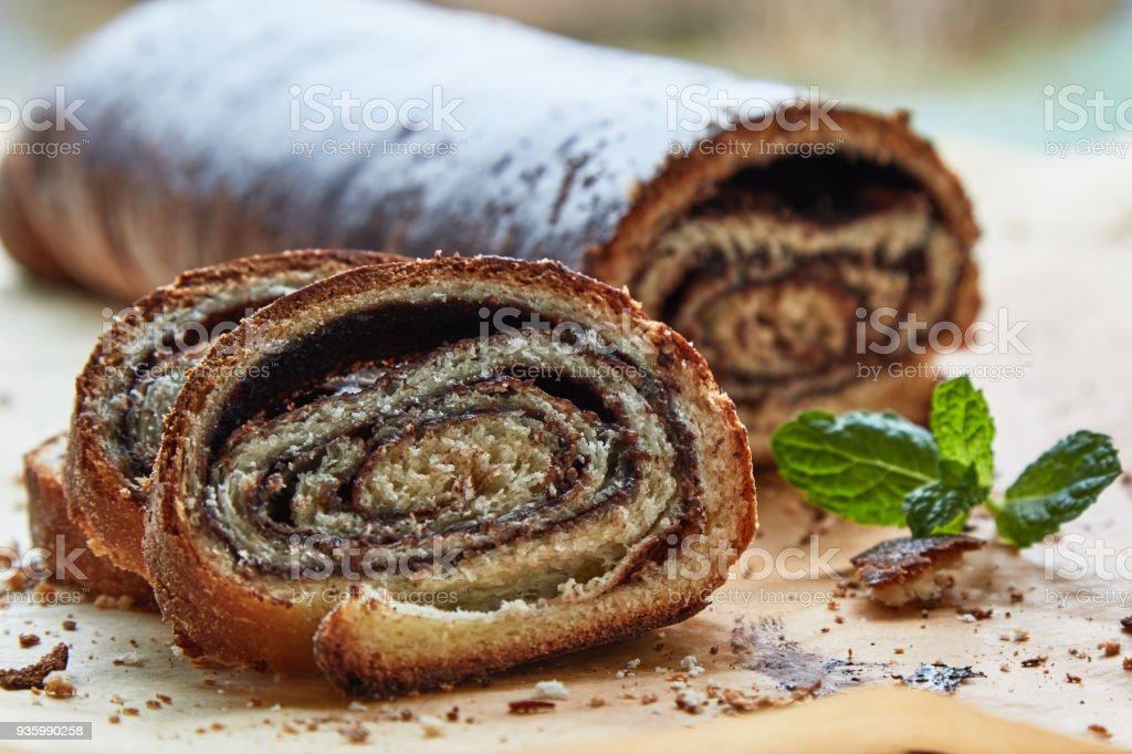 fresh rustic homemade chocolate filled strudel slice stock photo