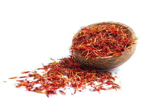 Fresh saffron isolated on white Bowl of fresh saffron isolated on white. saffron stock pictures, royalty-free photos & images