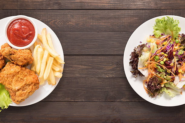 Fresh salad and Fried chicken and french fries on wooden. stock photo