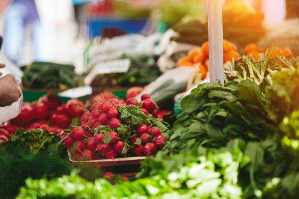 Fresh salad and radishes at Farmers' market stock photo