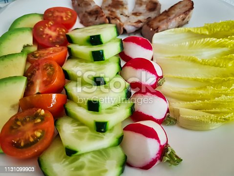 istock Fresh salad and tuna steaks behind 1131099903