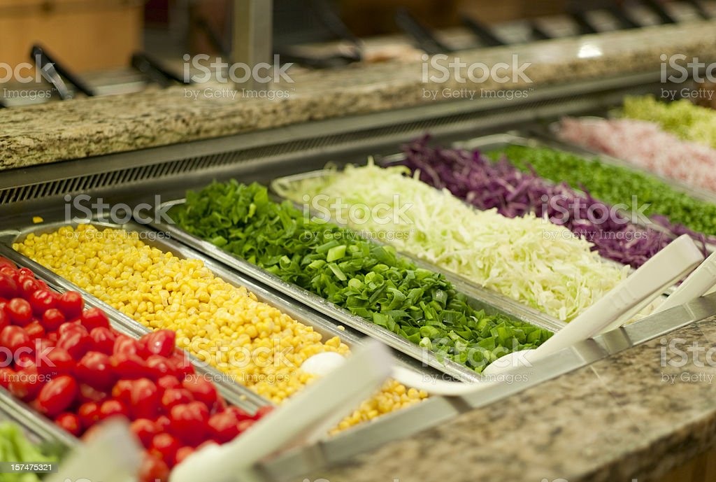 A fresh salad bar with granite edges stock photo