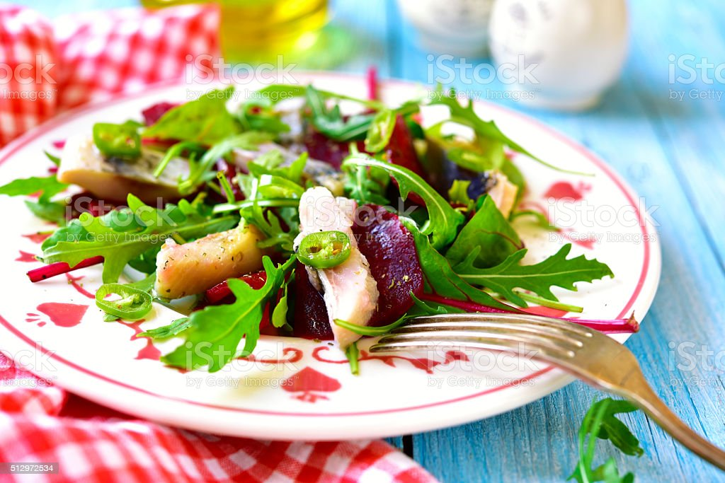Fresh salad from beetroot,herring,arugula and chard leaves. stock photo