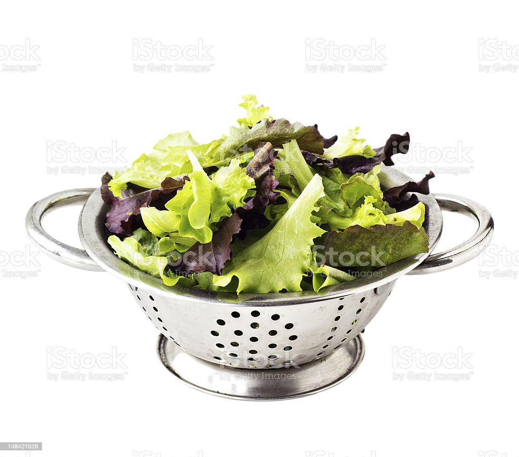 Fresh salad leaves in a metal collander stock photo