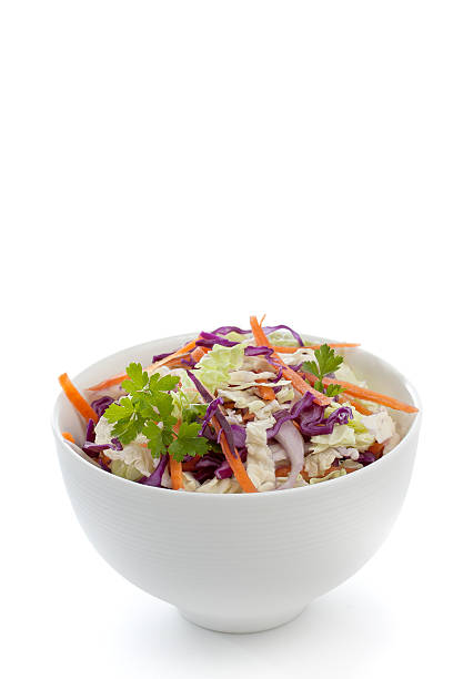 fresh salad made of cabbage in a white bowl - coleslaw stock pictures, royalty-free photos & images