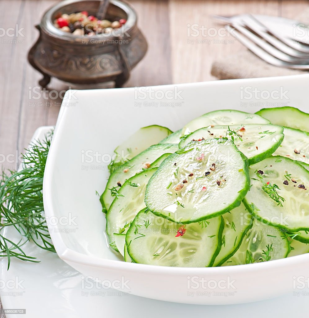 Fresh salad of cucumbers with dill and pepper stock photo