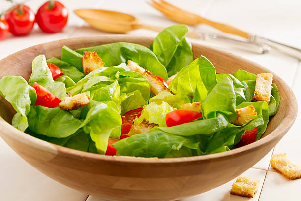 Fresh Salad A simple garden salad made with fresh boston leaf lettuce greens, tomatoes and homemade croutons. butterhead lettuce stock pictures, royalty-free photos & images