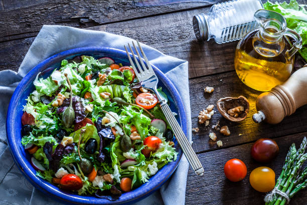 Fresh salad plate on rustic wooden table stock photo
