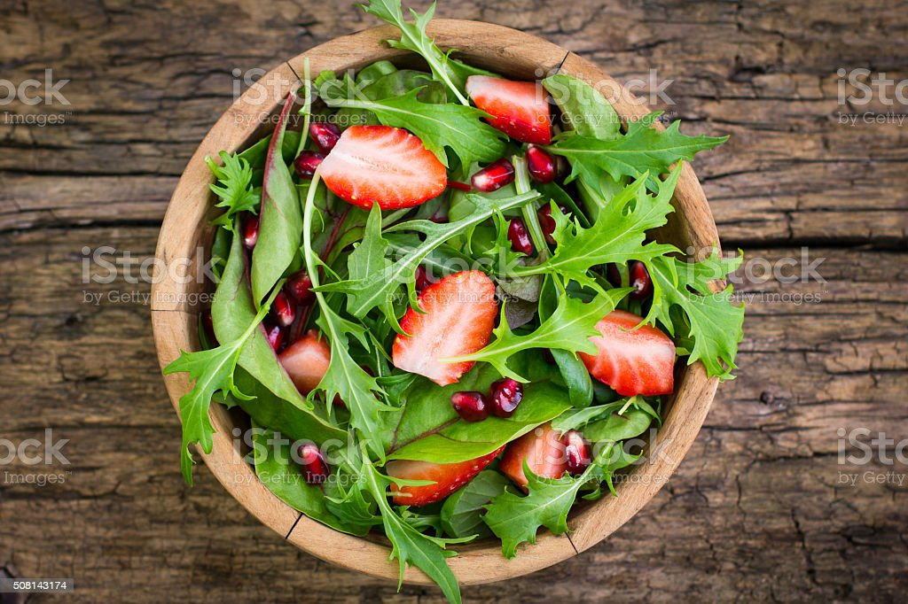 Fresh salad with arugula and strawberries stock photo