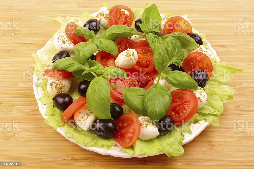 Fresh salad with basil, mozzarella, olives and tomato royalty-free stock photo