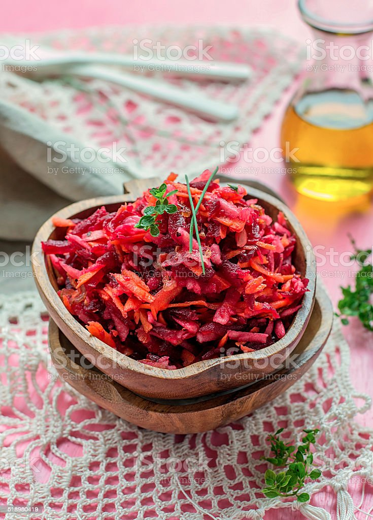 Fresh salad with beetroot, carrots and apples stock photo