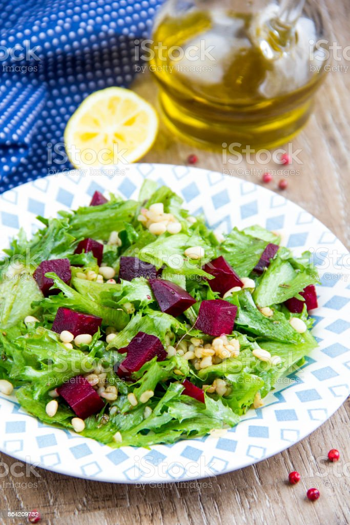 Fresh salad with beets, lettuce, pine nuts, bulgur, vegetarian summer dish royalty-free stock photo