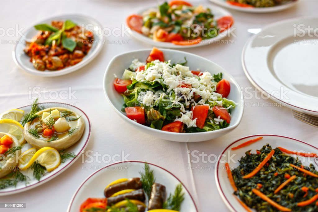 Fresh Salad with Cheese and Appetizers stock photo