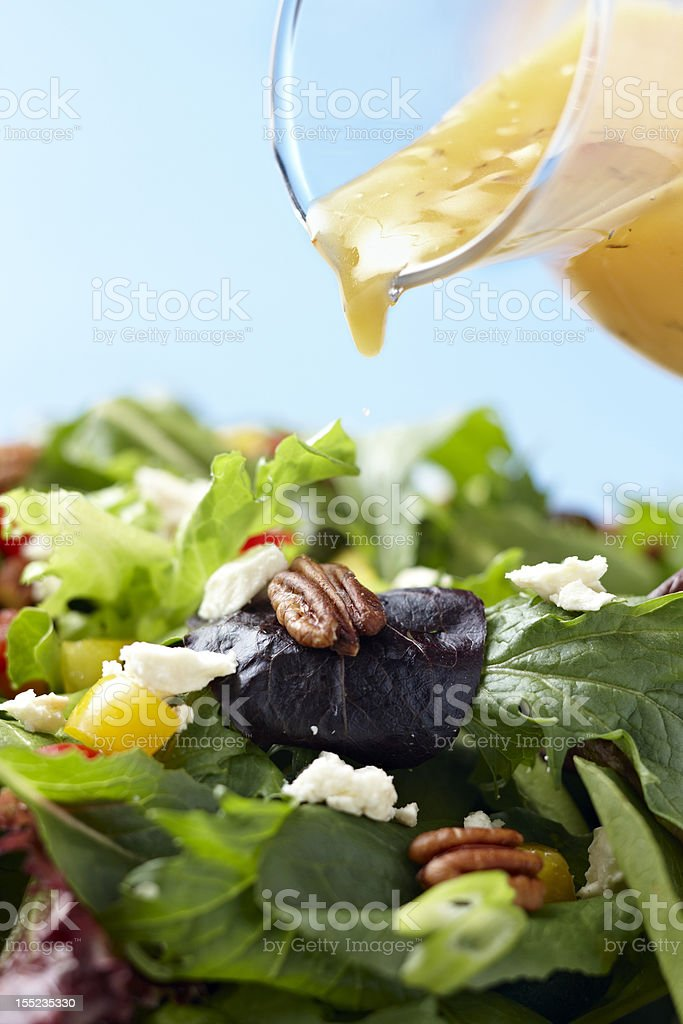 Fresh Salad with dressing pour stock photo