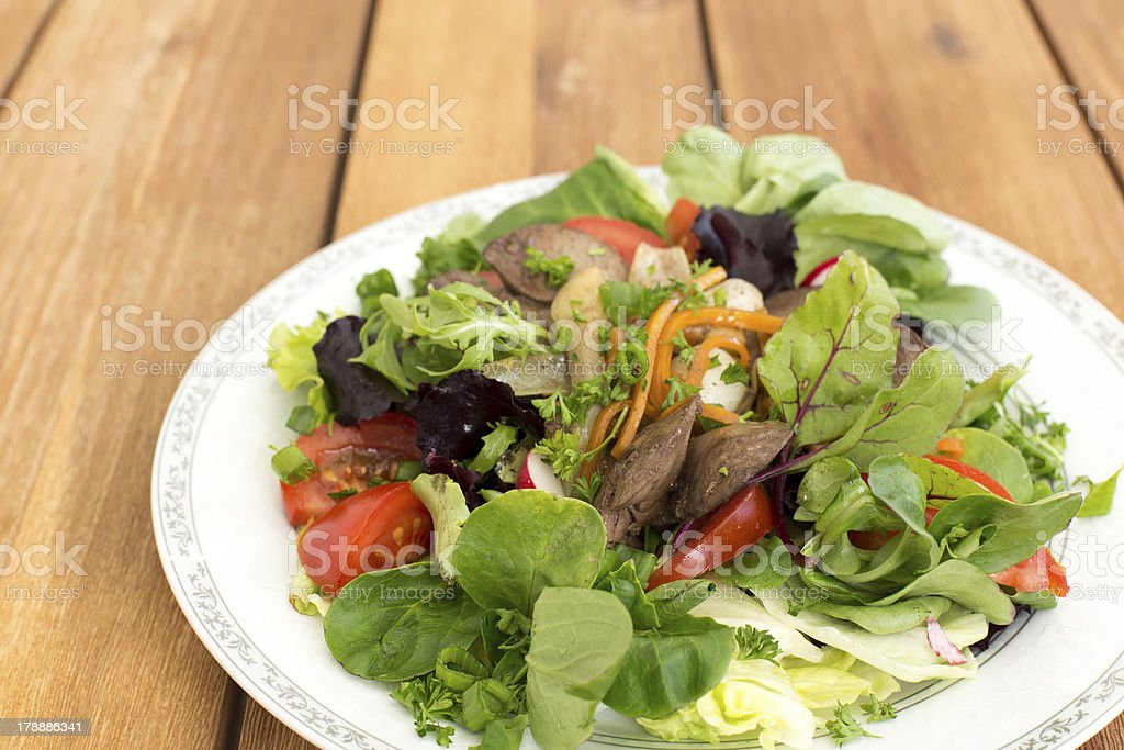 Fresh salad with liver royalty-free stock photo