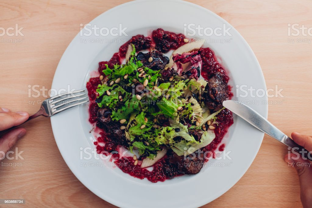 Fresh salad with liver, raspberries, pear, lettuce and pine nuts for lunch - Royalty-free Adult Stock Photo