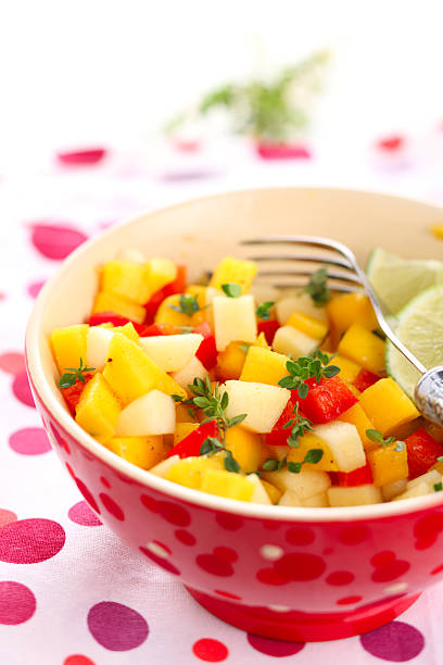 Fresh salad with mango, red pepper, apple and lemon thyme stock photo