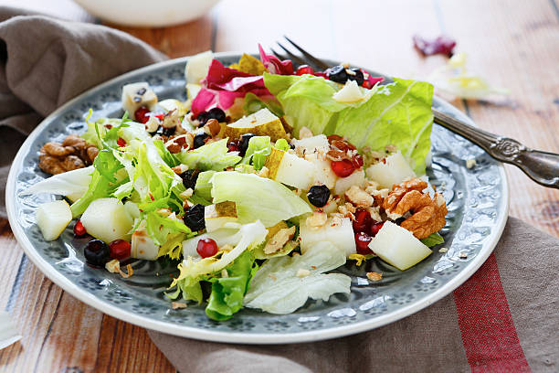 Fresh salad with pears stock photo