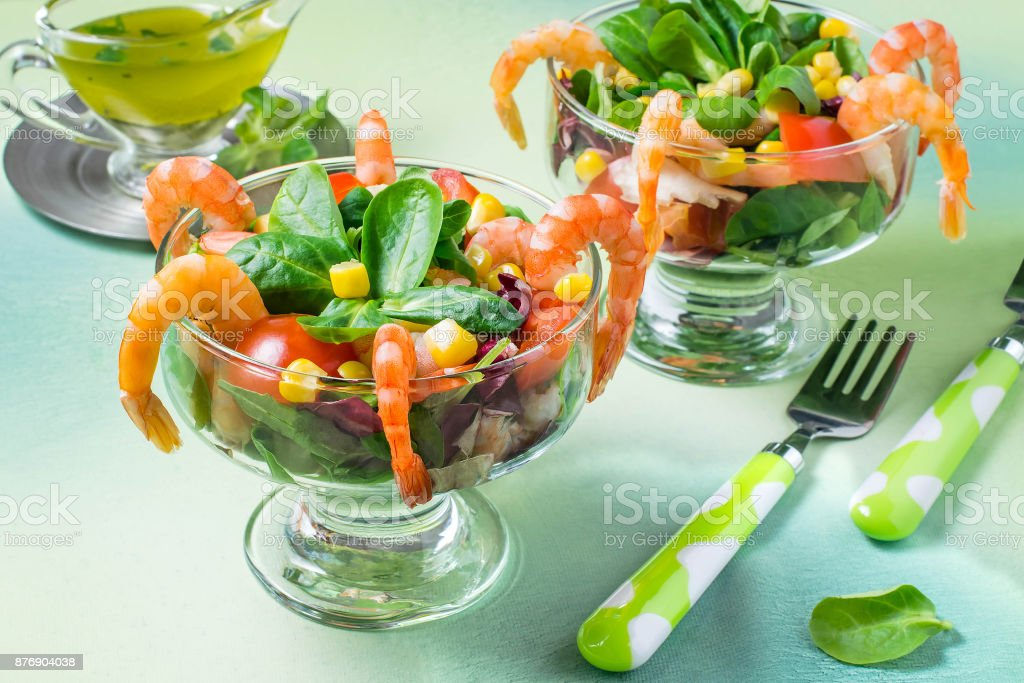 Fresh salad with shrimps, tomatoes, sweet pepper, corn and lettuce stock photo