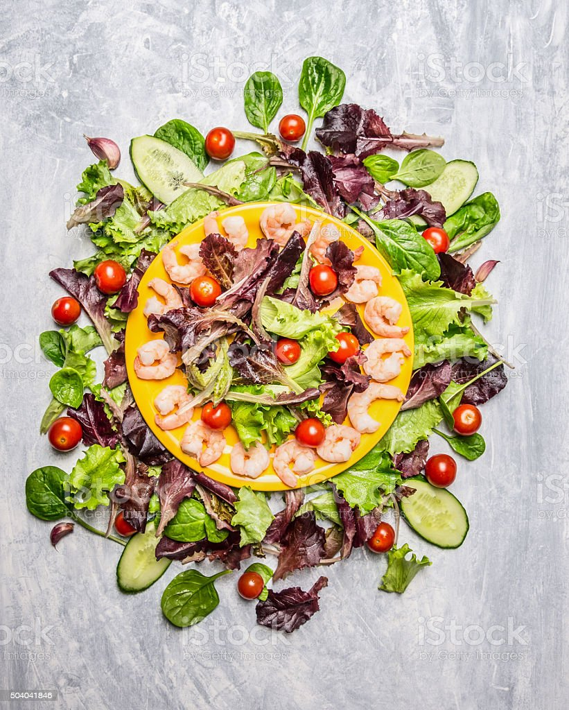 Fresh salad with shrimps, top view.  Healthy food stock photo
