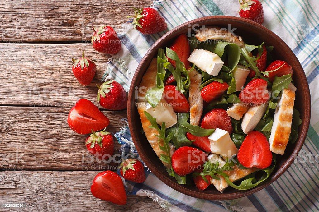 Fresh salad with strawberry, chicken, brie and arugula. horizontal stock photo