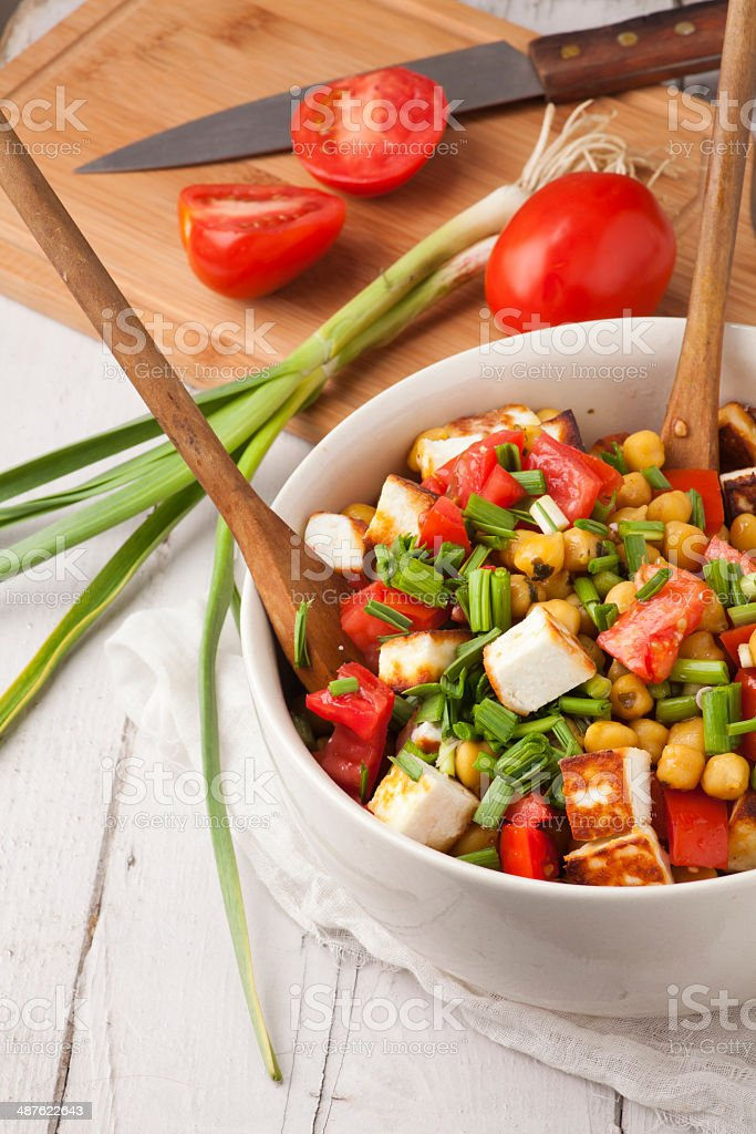 fresh salad with tomatoes garlic and chickpea stock photo