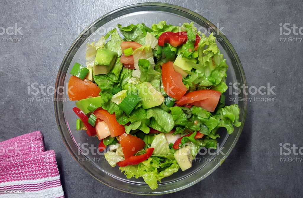 Fresh salad with tomatoes,avocado and green lettuce stock photo