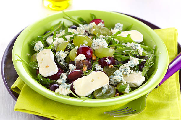 Fresh salad with variety of grapes and cheese stock photo