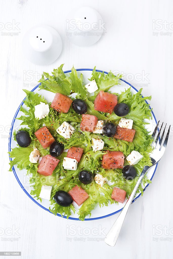 fresh salad with watermelon, feta cheese and olives, vertical royalty-free stock photo