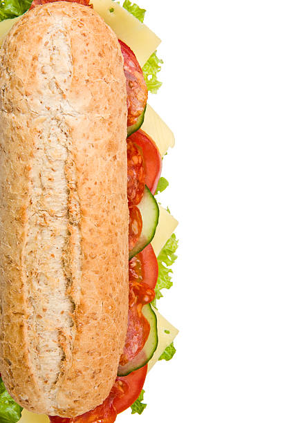 Fresh salami submarine sandwich on white Multi grain submarine sandwich with salami, lettuce, tomatoes and cucumbers, top view, isolated on white background submarine sandwich stock pictures, royalty-free photos & images