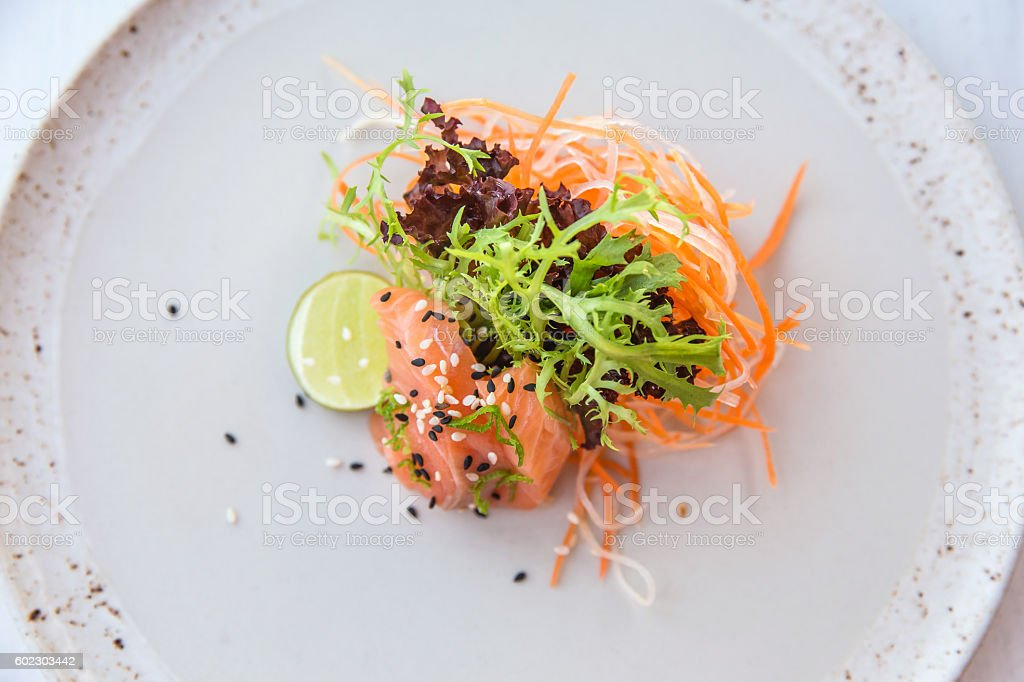 Fresh salmon and green salad stock photo