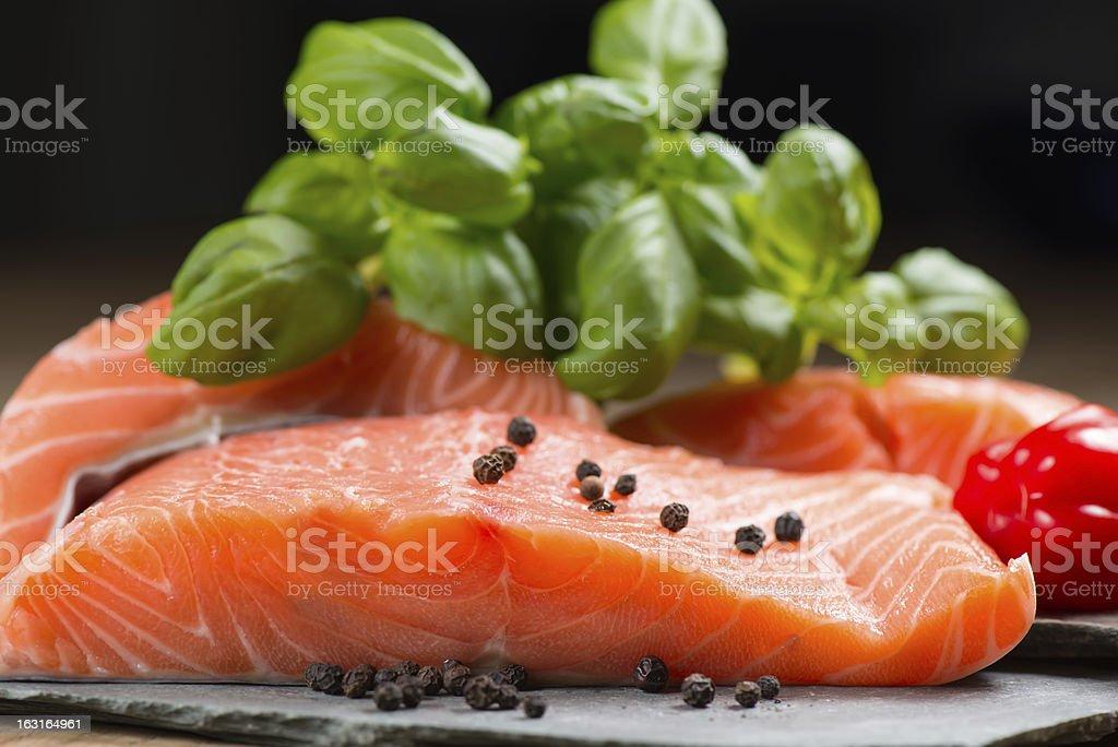 Fresh salmon fillet on rock royalty-free stock photo