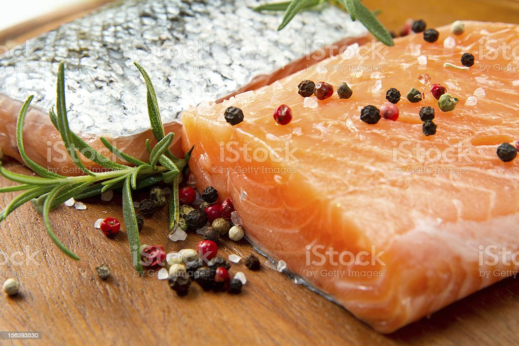 Fresh salmon fillet on wooden board royalty-free stock photo