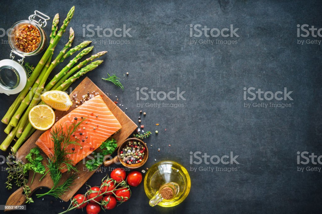 Fresh salmon fillet with aromatic herbs, spices and vegetables royalty-free stock photo