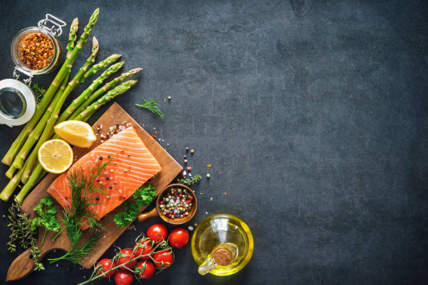 Fresh salmon fillet with aromatic herbs, spices and vegetables Fresh salmon fillet with aromatic herbs, spices and vegetables. Balanced diet or cooking concept preparing food stock pictures, royalty-free photos & images