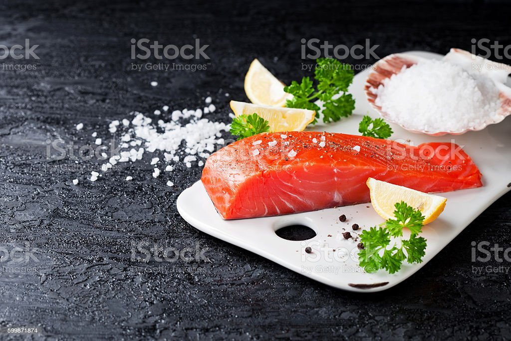 Fresh salmon fillet with spices stock photo