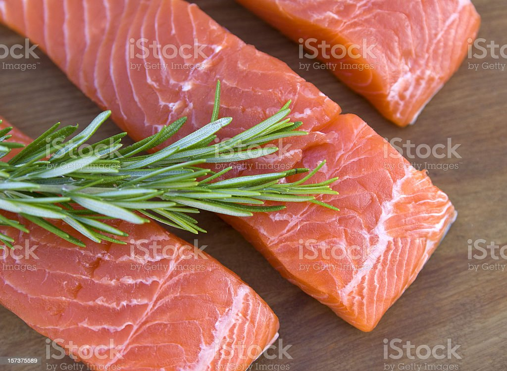Fresh Salmon Meat Fish, Raw Seafood Fillets & Rosemary Herb Background royalty-free stock photo