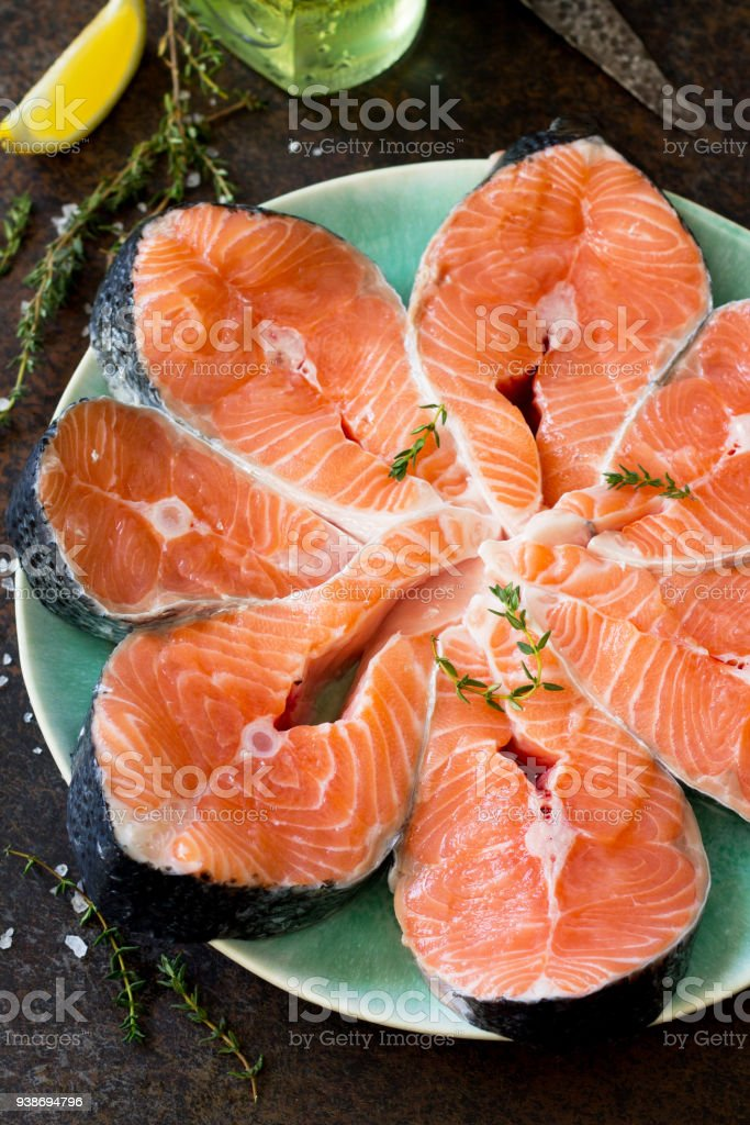 Fresh Salmon On A Dark Stone Table Preparation For Cooking
