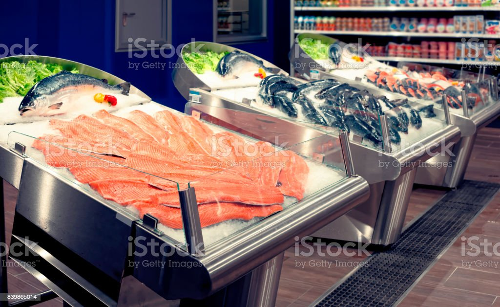Fresh salmon on ice, toned stock photo