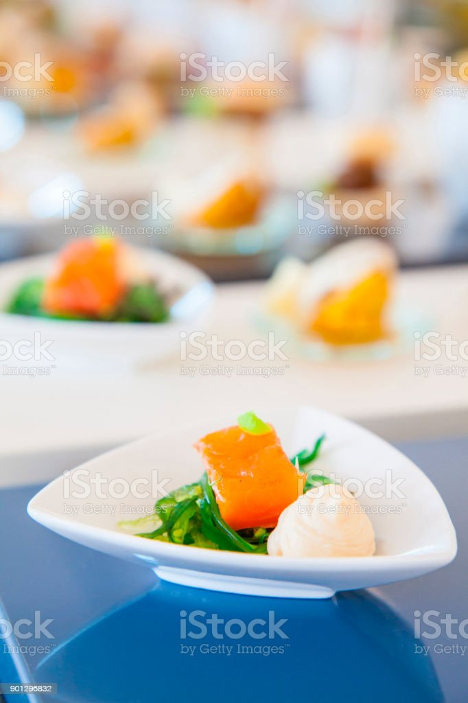 Fresh salmon on seaweed - gourmet style for catering stock photo