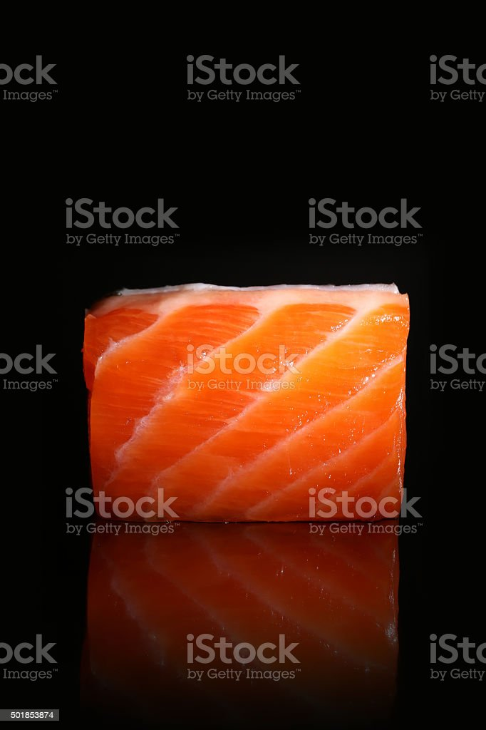 Fresh salmon piece isolated on black background stock photo