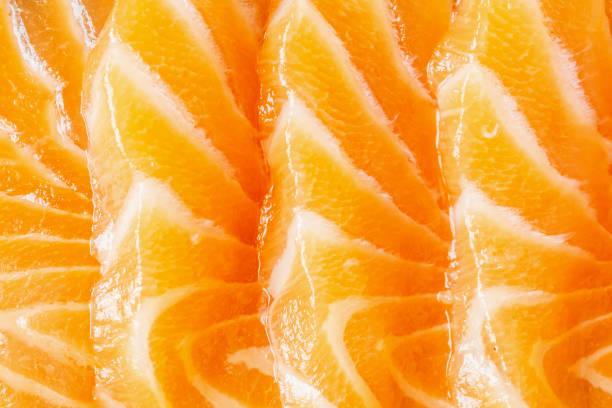 fresh salmon slice sashimi texture background - meat texture imagens e fotografias de stock