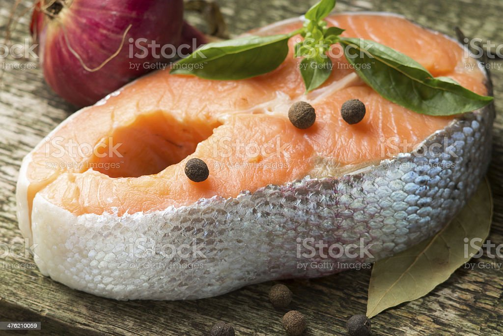 Fresh Salmon Steak on old Wood board royalty-free stock photo