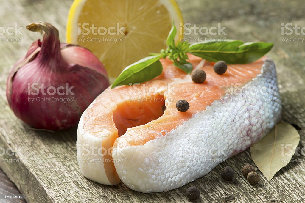 Fresh Salmon Steak on wood background royalty-free stock photo