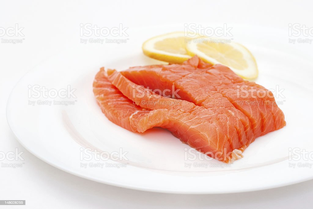 fresh salmon steak over white background royalty-free stock photo