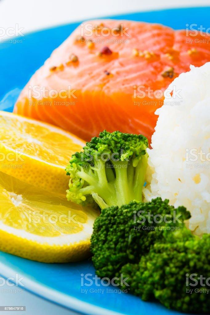 Fresh salmon steak with rice lemon and broccoli stock photo