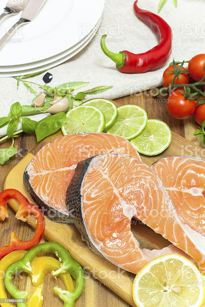 Fresh salmon, vegetables and herbs royalty-free stock photo