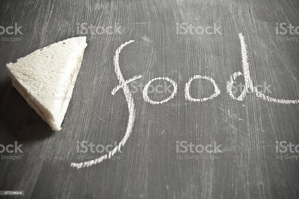 Fresh sandwich on black board and the word food royalty-free stock photo